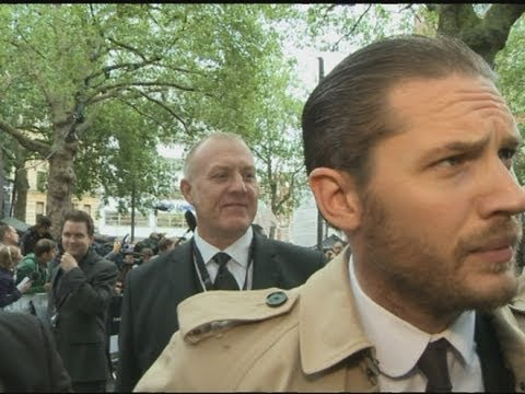 Tom Hardy kicks off with reporter at The Dark Knight Rises premiere, London