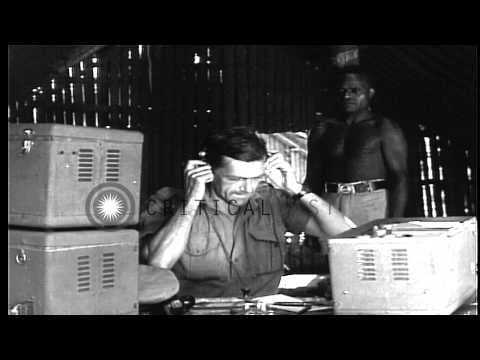 A Coast Watcher sends weather reports by radio set at a hut, at the Bougainville ...HD Stock Footage