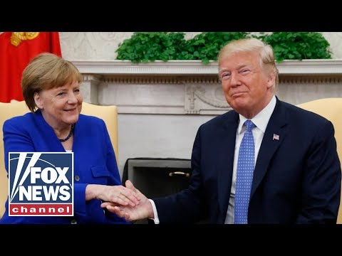 Trump blasts Russia 'Witch Hunt' at appearance with Merkel