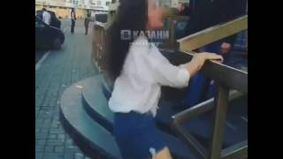 MAN PULLS DOWN WOMAN