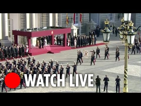 China's President Xi receives military parade in Madrid