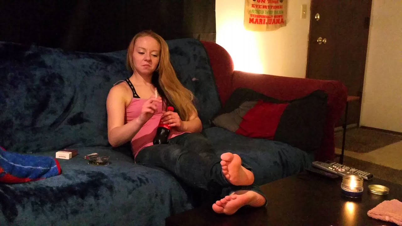 Ashley Smokes Barefoot Couch