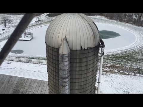 Lowering the unloader/ changing silo doors on the corn silo