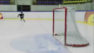 Kid Puts Out Candles With Hockey Puck
