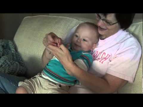 Evan plays patty-cake with Grandma