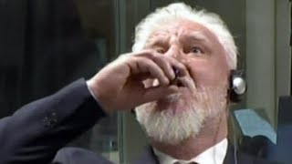 Convicted war criminal drinks deadly poison in court