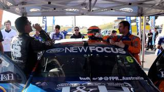 Ken Block gets behind the (right side) driver's seat of the Ford Fa...