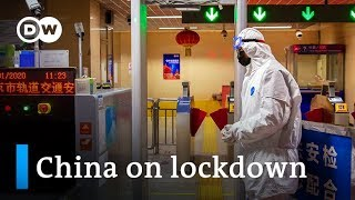 China puts millions under lockdown to contain Wuhan coronavirus | DW News