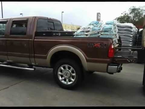 2011 F250 Super Duty being loaded with 3465lbs of Marble Rock