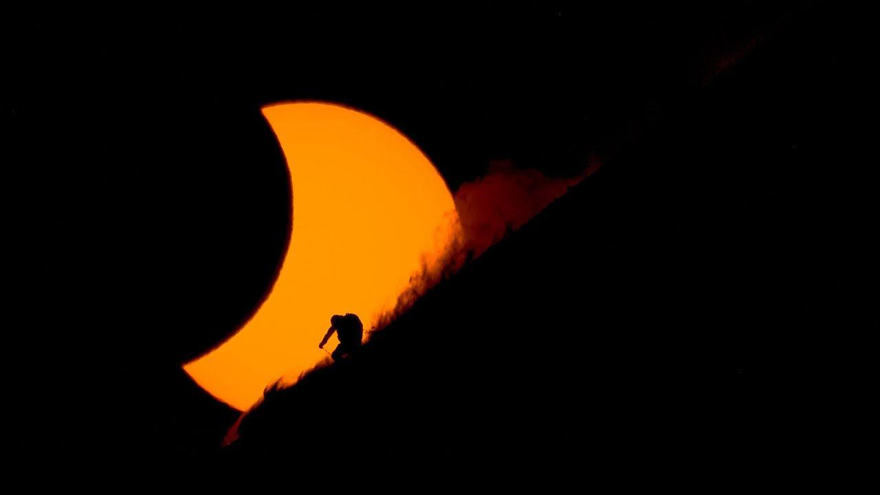 In A Flash Photographing Skiers During A Solar Eclipse