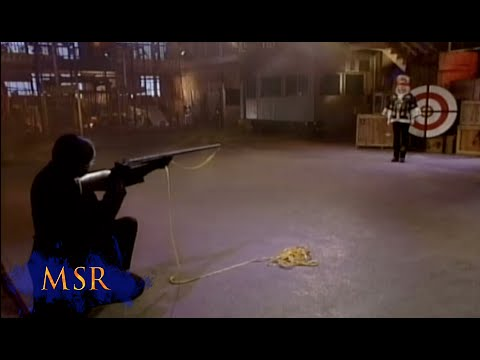BULLSEYE! MAGICIAN FIRES ARROW THROUGH ASSISTANT'S STOMACH--AND HITS THE TARGET!
