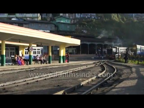 Steam engine train pulls into Darjeeling town - a slower train you never saw!