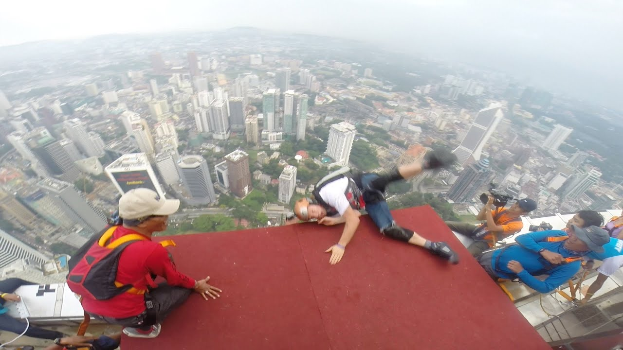 EPIC BASE JUMPING FAIL YouTube - Crazy guy base jumps radio tower