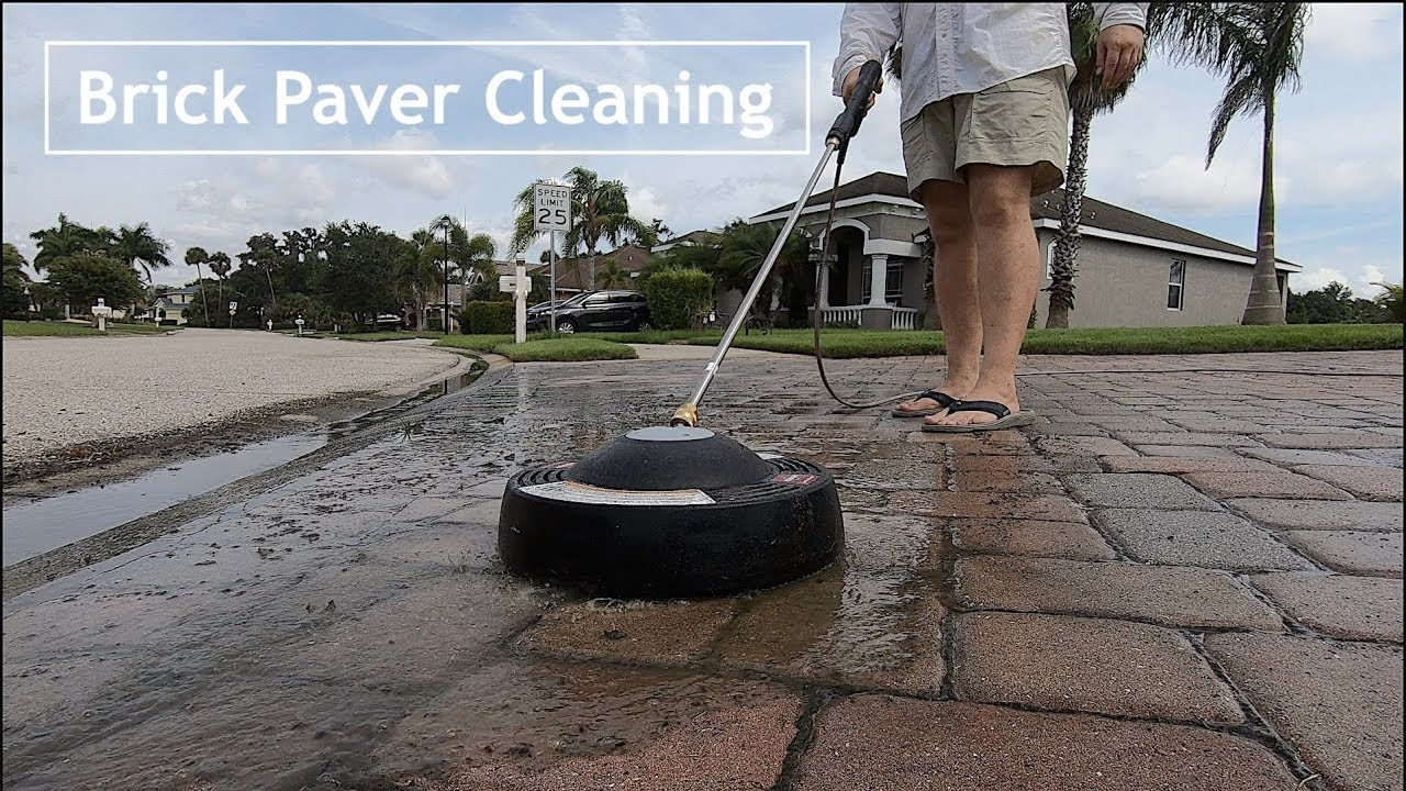 pressure washing brick paver driveway using a surface cleaning attachment