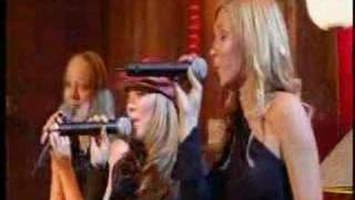 atomic kitten singing live Last Christmas......