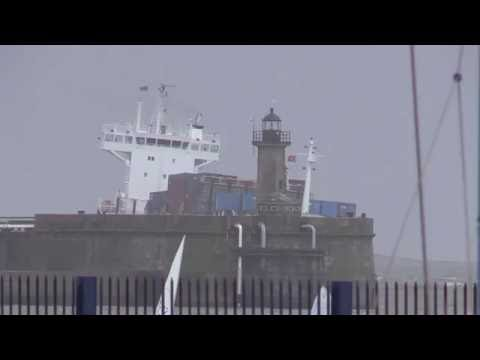 Container ship entering Leixoes harbour  in a storm (north of Portugal)