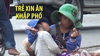 Trẻ em nói tiếng nước ngoài xin ăn khắp đường phố TPHCM