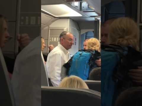 AA Flight attendant violently took a stroller from a lady with her baby