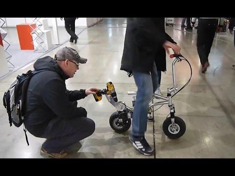 Аккумуляторный самокат -реклама литиевого шуруповерта.