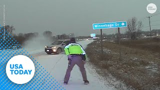 Driver on icy road just misses Wisconsin sheriff's deputy