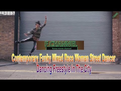 Contemporary Funky Mixed Race Woman Street Dancer Dancing Freestyle In The City