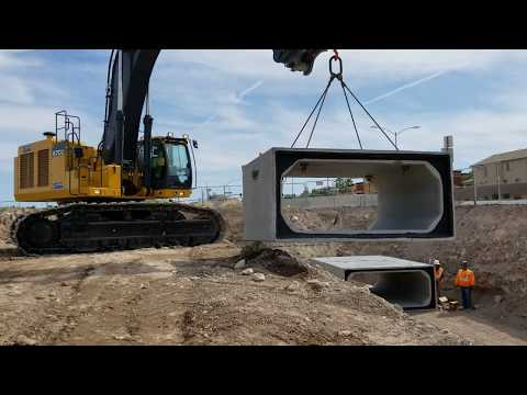 John Deere 670G Excavator Laying Concrete Bricks