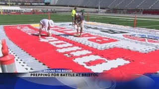 Crews paint center field logo ahead of Battle at Bristol