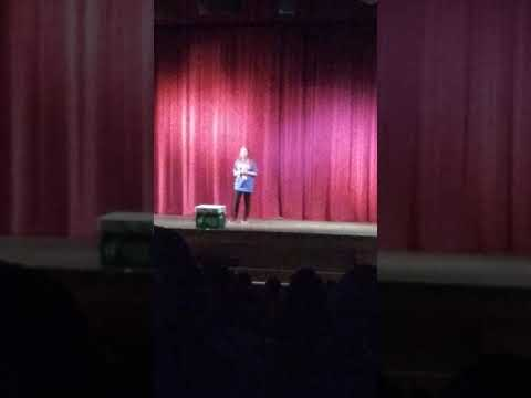 Ellise singing in the Trinidad middle school talent show