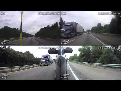 Big Truck Comes Over On Pilot Car