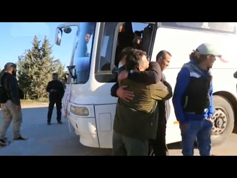 First group of evacuees from Homs arrive in northern Syria