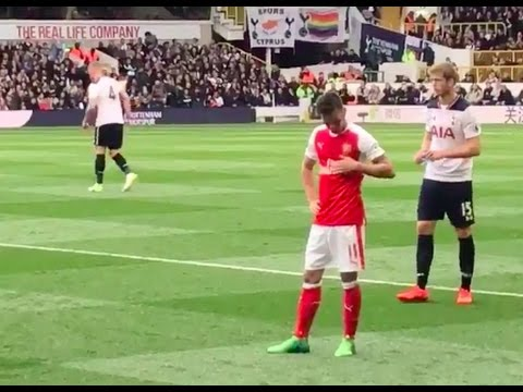 Mesut Ozil rubbing his Arsenal badge in front of Spurs fans