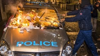 Protesters torch police car at #MillionsMaskMarch