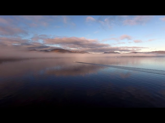 Jetskiers on a Misty Loch Lomond