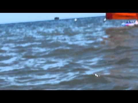 A woman is trying to be yachting, and Its look really fun, I was recorded this from the beach