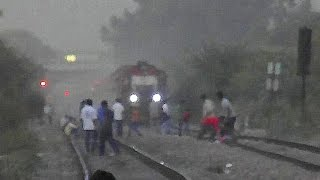 stupid boys placing big stones in tracks in front of speedy jaipur double decker express