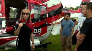 emt students examine a medical helicopter at college of dupage