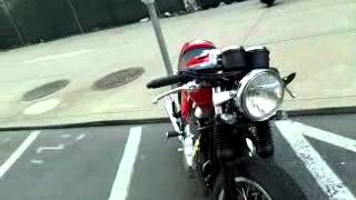 A Candy Apple Red Triumph Thruxton 900 Motorcycle real nice 4/3/12.