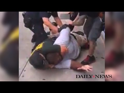 New York Police Killing of Eric Garner Spurs Debate on Chokeholds & Filming Officer Misconduct