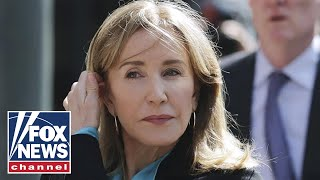 Felicity Huffman leaves court after sentenced to 14 days in prison