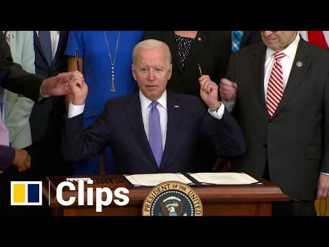 With too few pens to go around, Biden offers his own as souvenir at bill signing with lawmakers