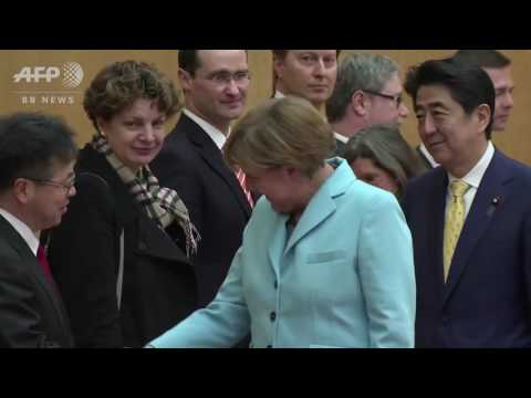 Angela Merkel  -  meets Shinzo Abe in Japan