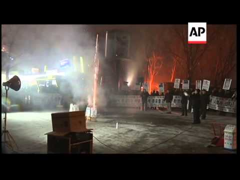 Anti-NKorea activists celebrate with fireworks as funeral held for Kim Jong Il