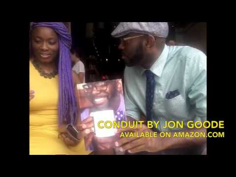 Ebony Janice getting her copy of Conduit A Collection of Poems and Short Stories by Jon Goode