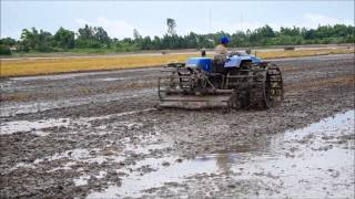 Actual operation of New Holland tractor TT45 on Vietnam fields   for LCD television