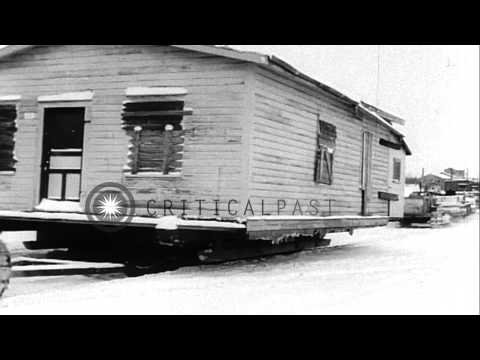 Town of Sherridon is moving on trailers to 167 miles north in Manitoba, Canada. HD Stock Footage