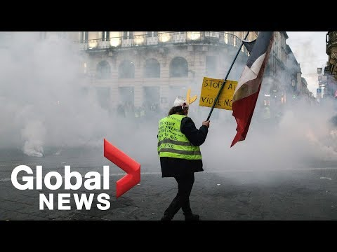 'Yellow vest' protesters clash with police in France during
