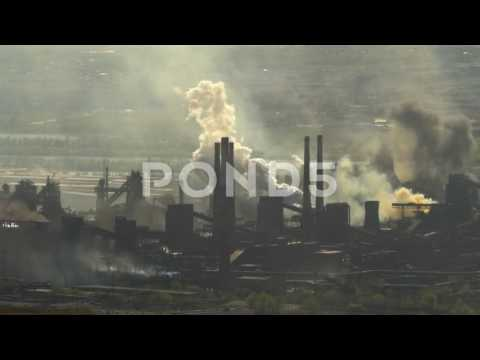 Pollution Large Factory Industry Against The Backdrop Of City Buildings In The
