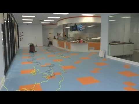 Applying Floor Finish to A New VCT Floor