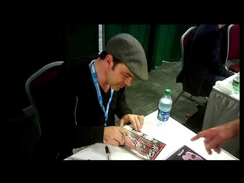 Actor Jed Rees signing autographs
