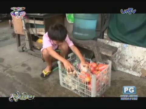 9-year-old boy sells vegetable on streets for a living